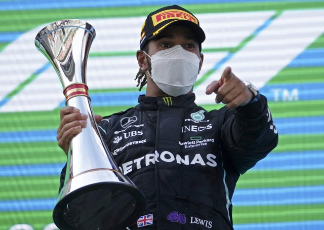 Mercedes driver Lewis Hamilton of Britain celebrates on the podium after winning the Spanish Formula One Grand Prix at the Barcelona Catalunya racetrack in Montmelo, just outside Barcelona, Spain, Sunday, May 9, 2021. (AP Photo/Emilio Morenatti)