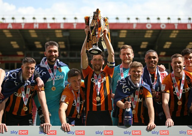 Hull City's Richie Smallwood (centre) and team-mates celebrate with the League One trophy. Picture: PA