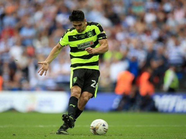 Huddersfield Town's Christopher Schindler scores the winning penalty to take the Terriers into the Premier League in May 2017. Picture: PA.