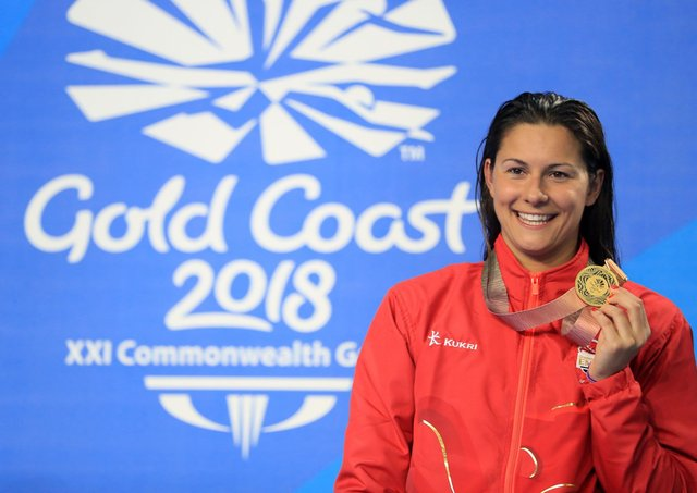 Life at the top: Aimee Willmott celebrates winning the 400m individual medley Commonwealth Games title in 2018, the medal highlight of a career that will now encompass three Olympic Games.(Picture: PA)