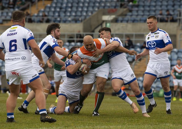 BACK AT IT: Hunslet's Alex Rowe takes some stopping by the Town's defence. Picture: Tony Johnson.