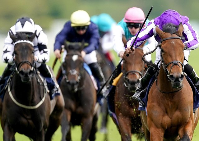 Snowfall ridden by Ryan Moore (right) on their way to winning the Tattersalls Musidora Stakes during day one of the Dante Festival at York Racecourse.