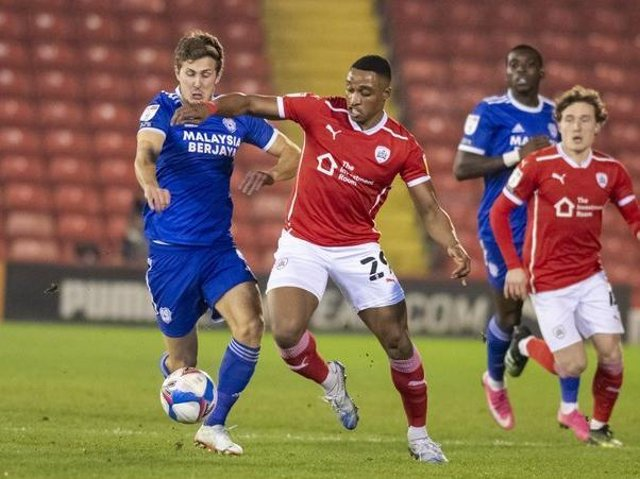 Barnsley's Victor Adeboyejo battles with Cardiff's Will Vaulks in their fixture at Oakwell in January. Picture Tony Johnson