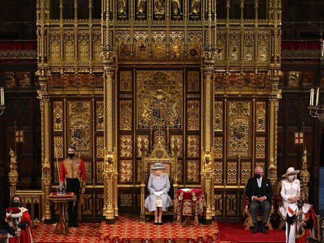 Queen Elizabeth II delivers a speech from the throne in House of Lords as she outlines the government's legislative programme for the coming session