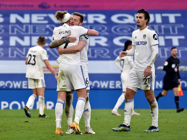 DECISION: Liam Cooper (hugging Luke Ayling) and Pascal Struijk (far right) are vying to be Leeds United's left-sided centre-back at Burnley