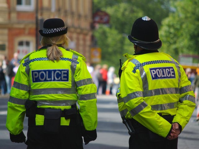 Five men have been arrested after allegedly posing as police officers to steal cash, detectives have said