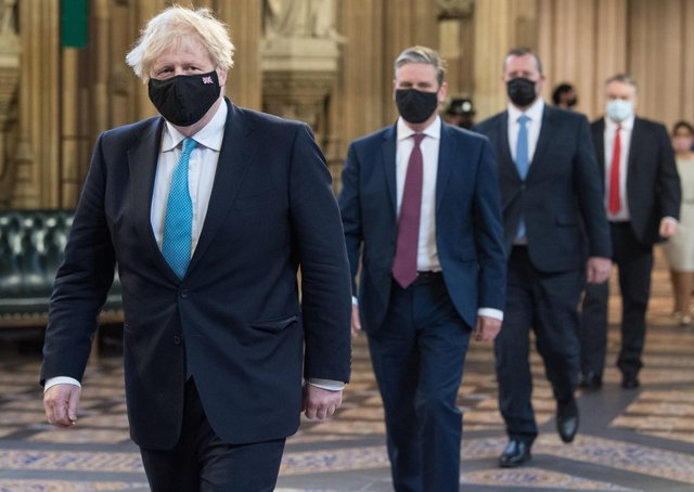 Prime Minister Boris Johnson (left) and Labour leader Sir Keir Starmer (2nd left) walk through the Central Lobby on the way to the House of Lords to listen to the Queen's Speech. Picture: Stefan Rousseau/PA Wire