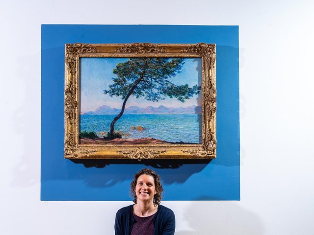 Ferens Art Gallery in Hull is to exhibit a painting by Impressionist Claud Monet as it reopens on Monday. Pictured Claire Longbrigg, exhibition officer, with the painting Antibes, 1888. Image by James Hardisty