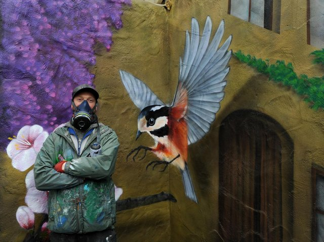 Pictured Sam Porter Harrogate bases artist at work on his new mural at the Two Brothers Restaurant, Grill & Pizzeria, Castle Courtyard, Knaresborough. Photo credit: JPIMedia/Gerard Binks