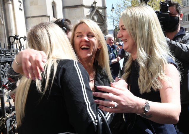 Former post office worker Janet Skinner (centre), with her niece Hayley Adams (right) and her daughter Toni Sisson, celebrating outside the Royal Courts of Justice, London, after having her conviction overturned by the Court of Appeal. Thirty-nine former subpostmasters who were convicted of theft, fraud and false accounting because of the Post Office's defective Horizon accounting system have had their names cleared by the Court of Appeal.