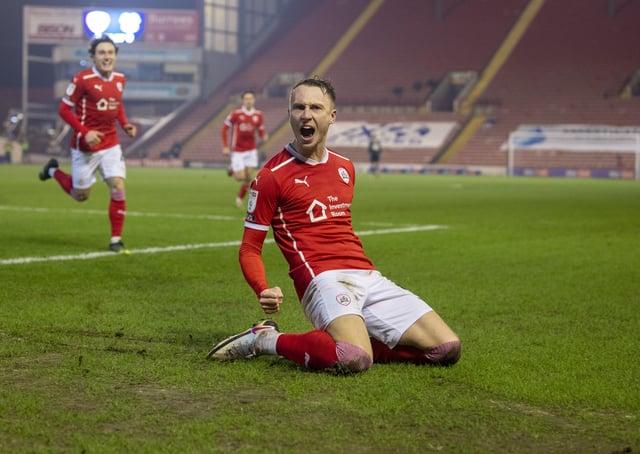 On target: Cauley Woodrow celebrates scoring against suitors Cardiff City. Picture: Tony Johnson