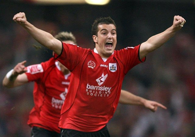 Victory charge: Barnsley's Dale Tonge leads the celebrations.