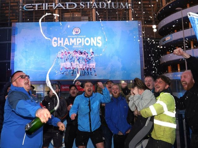 WINNERS: Manchester City fans celebrate their title win