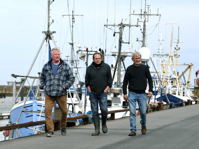 Fishermen, from left, Andrew Sanderson, Frank Powell and Shaun Wingham, pictured at Bridlington harbour. Picture: Jonathan Gawthorpe