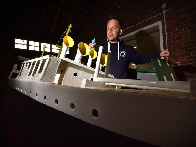 The Scarborough Naval Warfare Battle ships are currently in storage at Scarborough's Council depot where maintainance is taking place before the season starts..Naval Warfare Coordinater Damien Rhodes painting one of the boats . Image by Richard Ponter