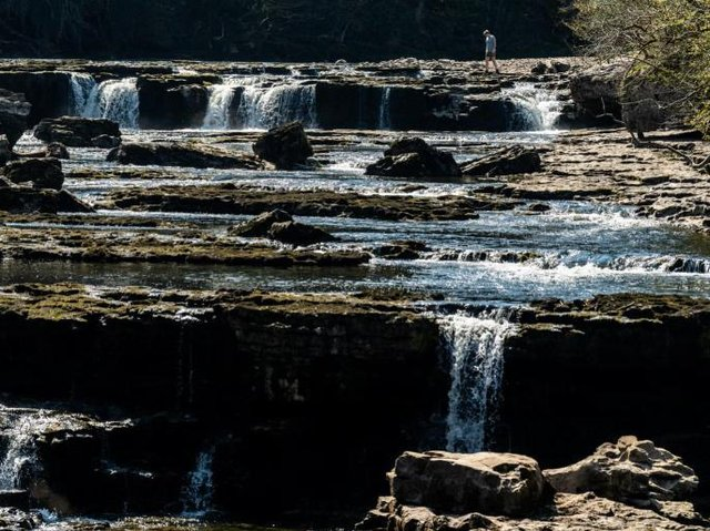Aysgarth Falls, one of the Yorkshire Dales most famous landmarks, is a triple flight of waterfalls