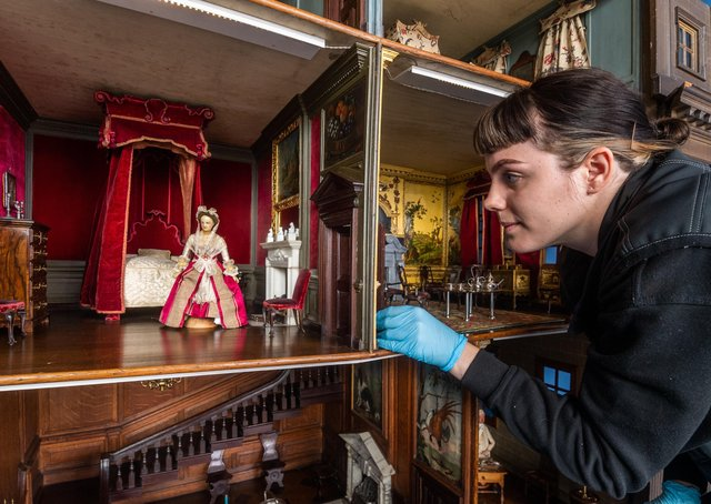 Sophie Bryan, Collections Assistant for the National Trust at Nostell Priory, taking great care to inspect the famous Dolls House before cleaning.