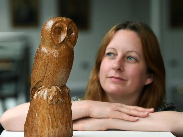 Diane Sinnott with the Mouseman owl carving