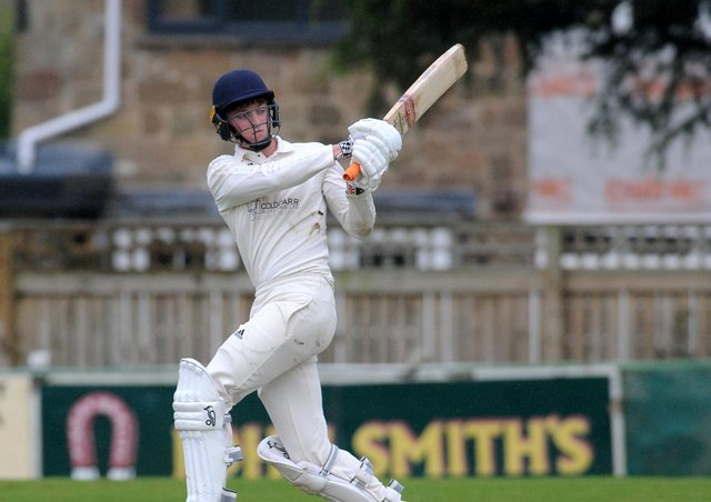 Match-winner: Collingham teenage wicketkeeper/bastman Daniel Kilby, who scored 50 from 45 balls with 6 fours and 3 sixes to help his side reach the revised 115 off 28 overs after North Leeds hit 151 in the Aire-Wharfe League. Picture: Steve Riding