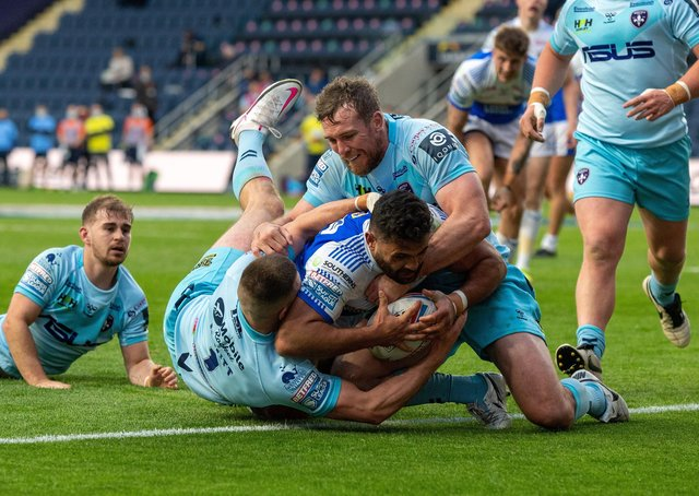 Rhyse Martin heads for the line to score the Rhinos' first try.   Pictures:  Bruce Rollinson
