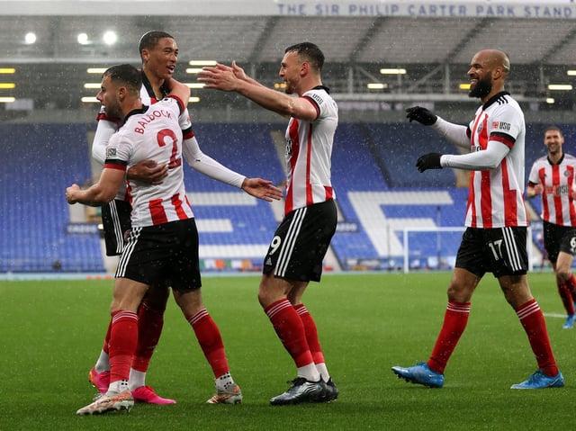 History maker: Sheffield United striker Daniel Jebbison, left, celebrates with his team-mates after his goal at Goodison Park.