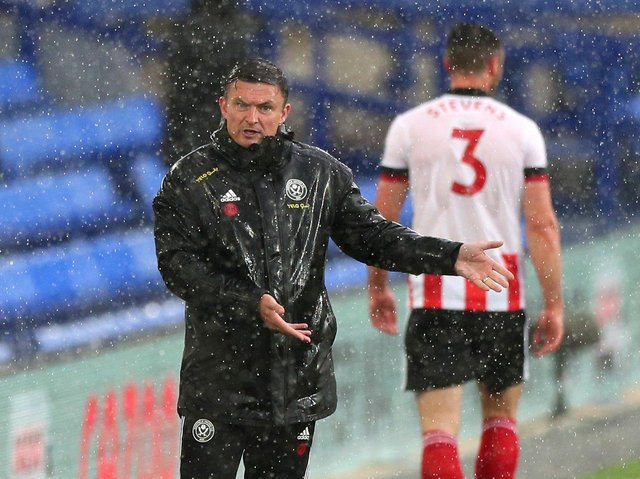 Sheffield United interim manager Paul Heckingbottom pictured in the incessant rain at Goodison Park.
