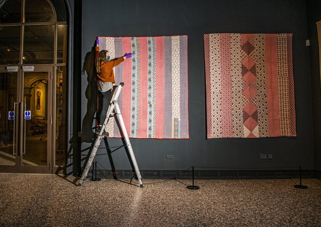 Exhibition assistant Catherine Dickinson with a quilt made by Hannah Hauxwell's grandmother Elizabeth Bayles is to feature in a new exhibition having been secured at auction by the Bowes Museum in Barnard Castle.  Picture Tony Johnson