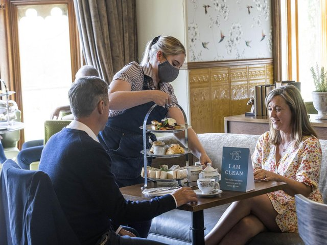 Guests at Studley Castle Hotel in Warwickshire eat at the Evesham restaurant as Warner Leisure hotel group re-opens all 14 of its properties in England and Wales today following the latest easing of the coronavirus lockdown measures. Picture: Fabio De Paola/PA Wire