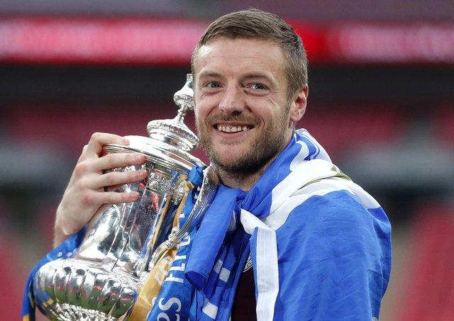 Leicester City's Jamie Vardy celebrates with the trophy.