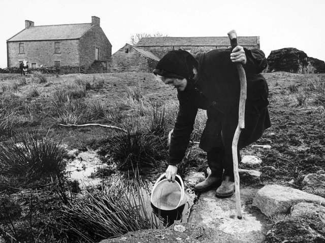 Hannah Hauxwell drawing her water for domestic use at her farm in Baldersdale in the early 1980s