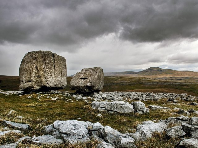 The Cheese Press stone above the limestone escarpment of Kingsdale north of Ingleton looking towards Ingleborough. Picture: Bruce Rollinson