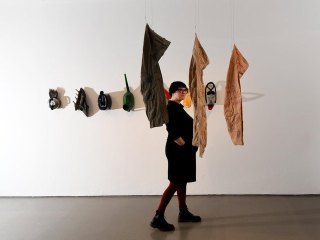 The curator with work by Andrea Zittel.