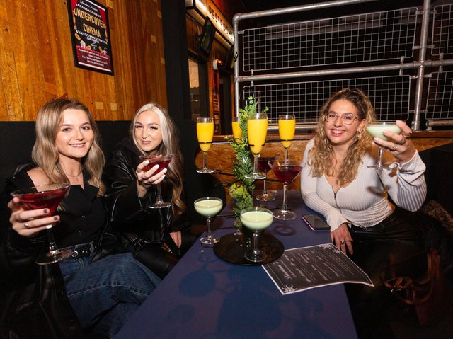 L-R Rosie Delaney, Isobel Logan and Rebecca Mitchell enjoy a cocktail at Showtime Bar, in Huddersfield. (SWNS)
