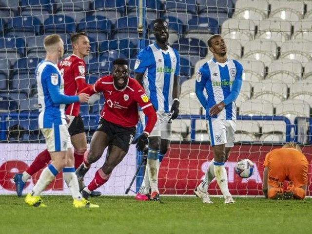Barnsley FC striker Daryl Dike pictured celebrating after scoring in the 1-0 derby win at Huddersfield Town. Picture: Tony Johnson.