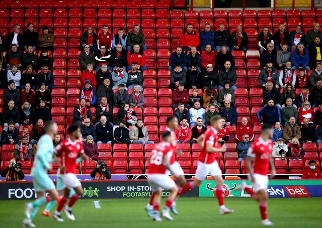 GOOD TO BE BACK: Barnsley fans watch from the stands at Oakwell. Picture: Nick Potts/PA