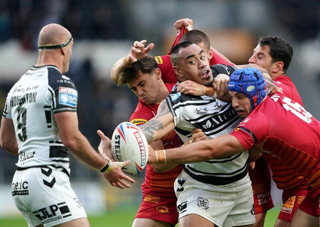 Hull FC's Mahe Fonua (middle) is tackled by Catalans Dragons' Benjamin Jullien. Pictures: Zac Goodwin/PA Wire.