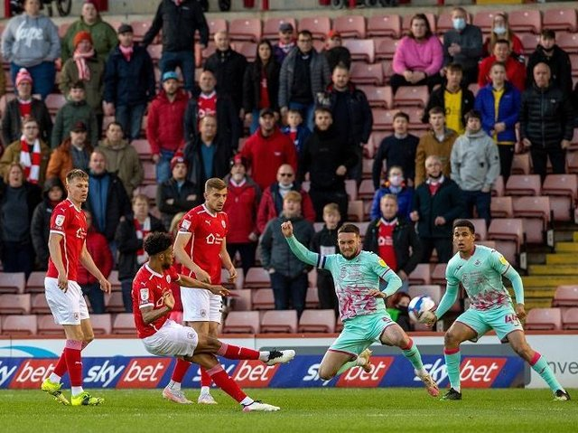 AT LAST! Barnsley supporters watch on from the Oakwell stands as their team take on Swansea in the playoff semi-finals.