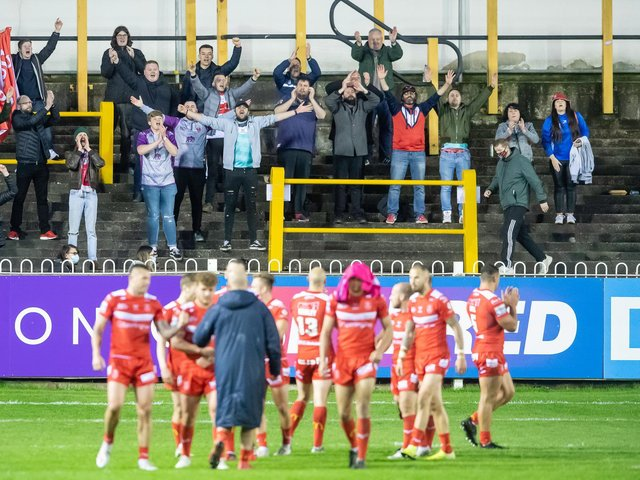 A handful of Hull KR fans who managed to get in tonight's restricted capacity game at Castleford Tigers celebrate their side's win. (ALLAN MCKENZIE/SWPIX)