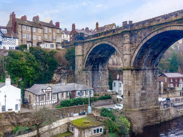 The house, left, sits next to naresborough viaduct, which was opened on on October  1,1851. It has castellated walls and piers to blend in with the ruined walls of Knaresborough Castle and consists of four arches and three piers, the middle of which stands in the river.
