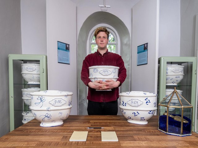 Harry Jelley, the audience development officer for the Brontë Parsonage Museum in Haworth, is pictured with ceramic works by artist Layla Khoo. The museum re-opened to the public on Wednesday, May 19, after the latest easing of lockdown restrictions. (Picture: James Hardisty)