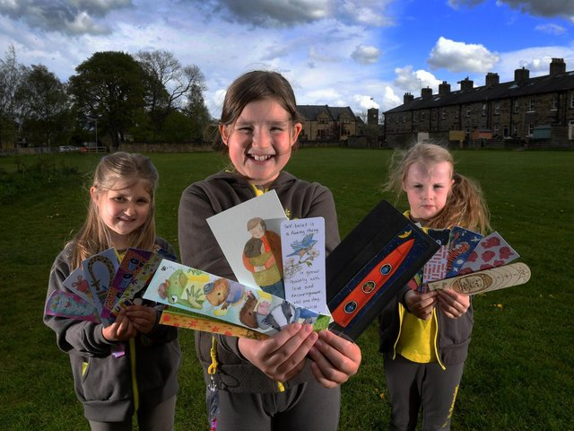 Pictured from the left are Olivia Frobisher, Mabel Tricklebank and Evie Harding with some of the bookmarks. Picture by Simon Hulme