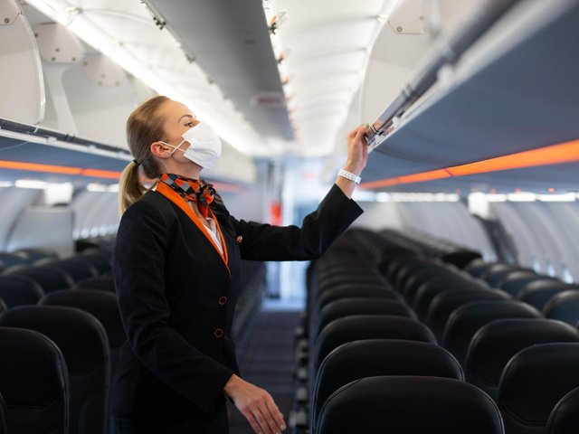 Crew prepare the first holiday and leisure flight for take-off at Gatwick Airport,