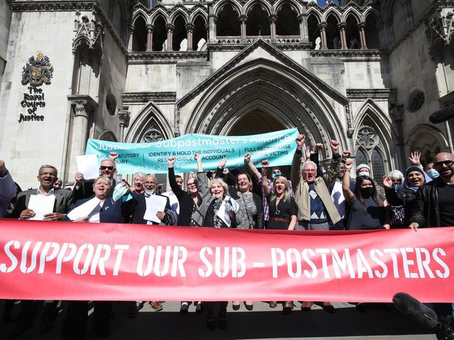 Former post office workers celebrating outside the Royal Courts of Justice, London, after their convictions were overturned by the Court of Appeal in April