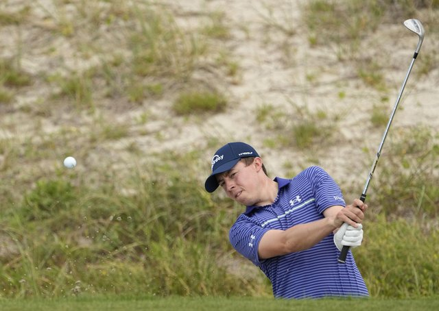 Sandy backdrop: Sheffield's Matt Fitzpatrick hits out of a bunker on the 15th hole of the Ocean Course at Kiawah Island. (Picture: AP)