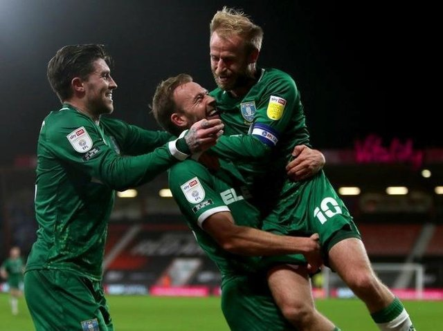 Sheffield Wednesday's Jordan Rhodes (centre) celebrates with his team-mates after his winner at Bournemouth earlier this season. Picture: PA