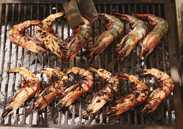 Grilled prawns from Chasing Smoke: Cooking over fire around the Levant by Sarit Packer & Itamar Srulovic Picture: Patricia Niven