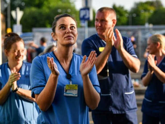NHS staff at the Queen Elizabeth Hospital in Glasgow take part in the 'Clap for Carers' in May 2020