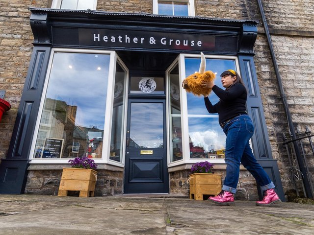 Roxy Cloughton with one of her All Creatures Great and Stuffed creations outside Heather & Grouse