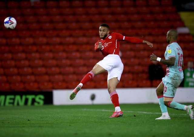 Making a difference: Barnsley's Carlton Morris attempts a shot during the first leg. Picture: PA