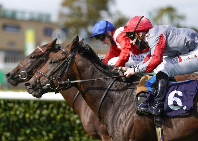 Rowan Scott riding Ubettabelieveit (number six) win The Bombardier Flying Childers Stakes during day three of the William Hill St Leger Festival at Doncaster Racecourse.